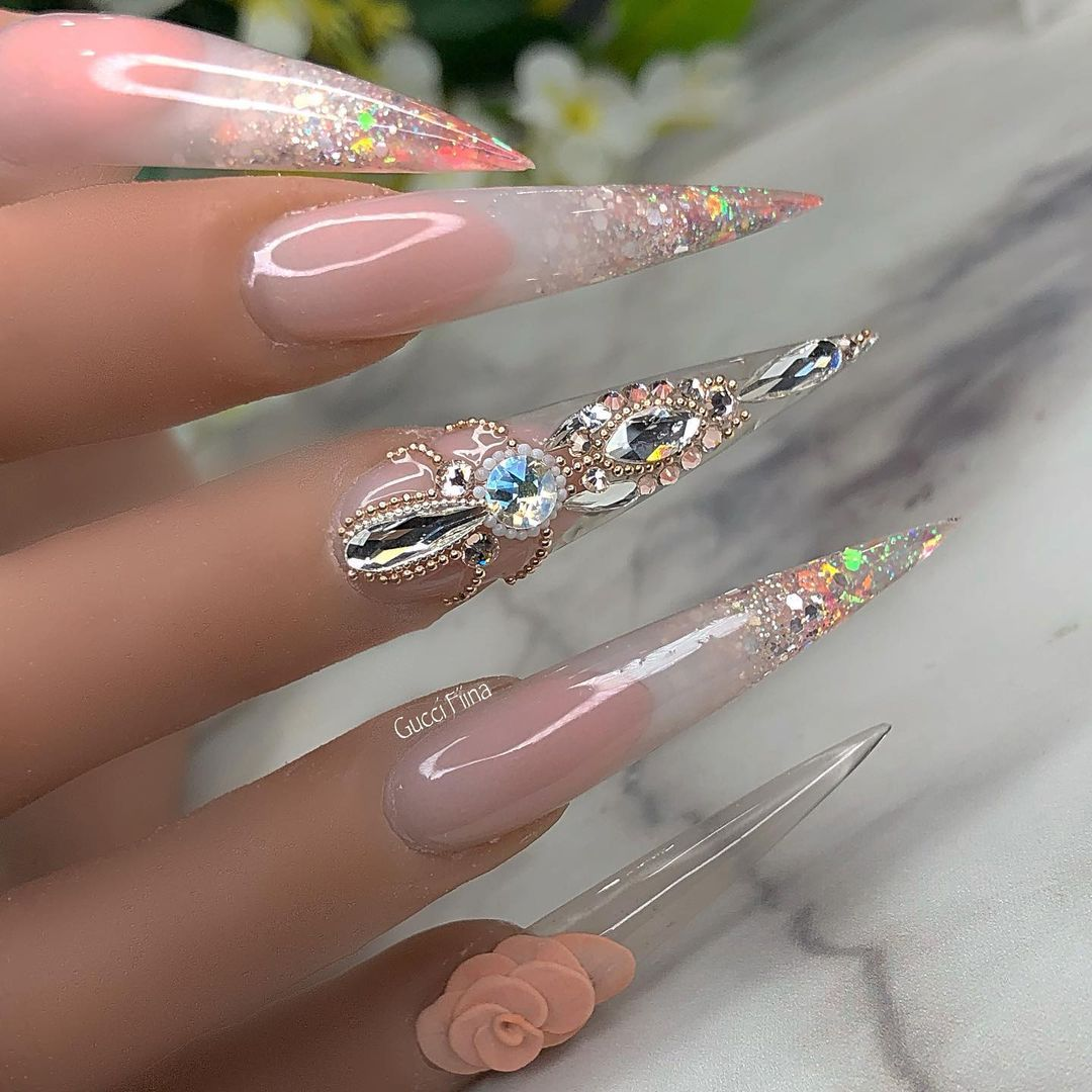 Bling fingernails Glittering Long Stiletto Tip Nails with Transparent Nail Polish and Rhinestones