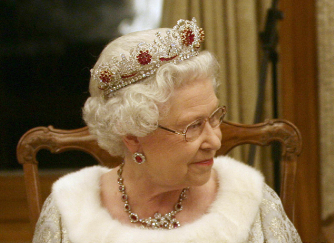 Royal bling Queen Elizabeth II wears Queen Mary's Ruby Cluster Tiara, Earrings and Necklace