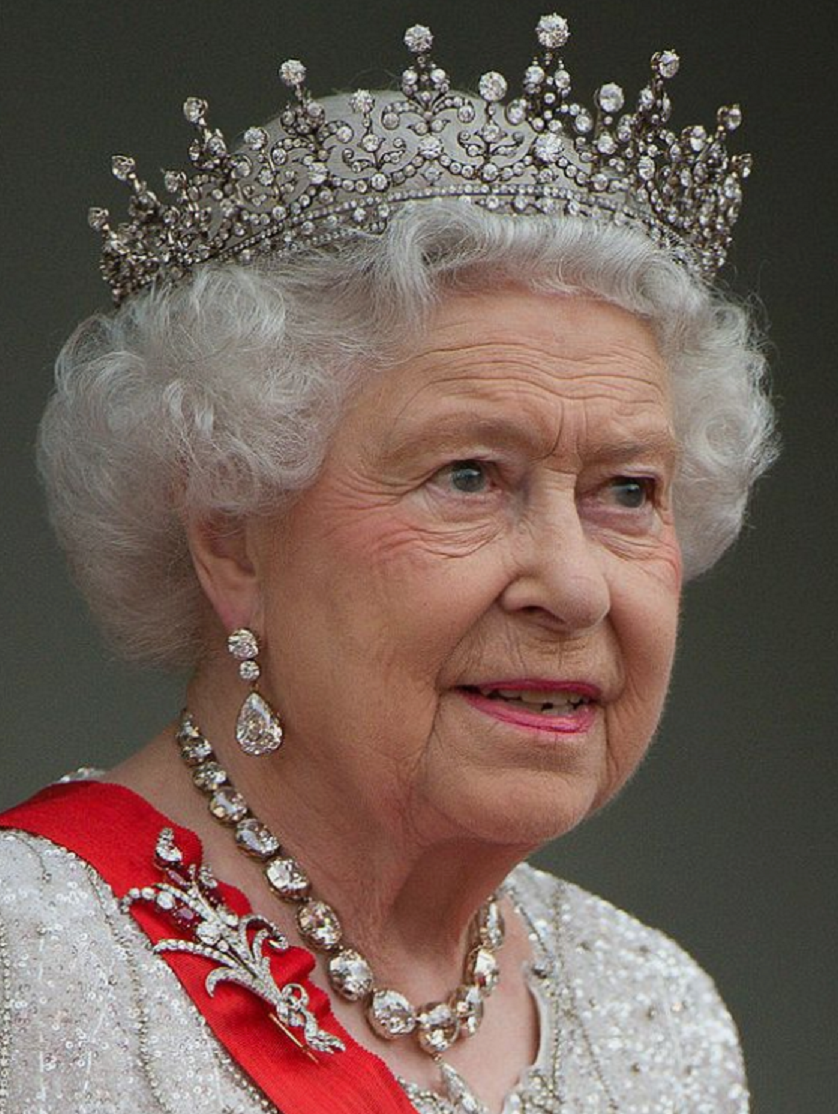 Royal bling Queen Elizabeth II At The Elysee Palace For A State Dinner with Her Majestic Crown and Matching Earrings and Necklace