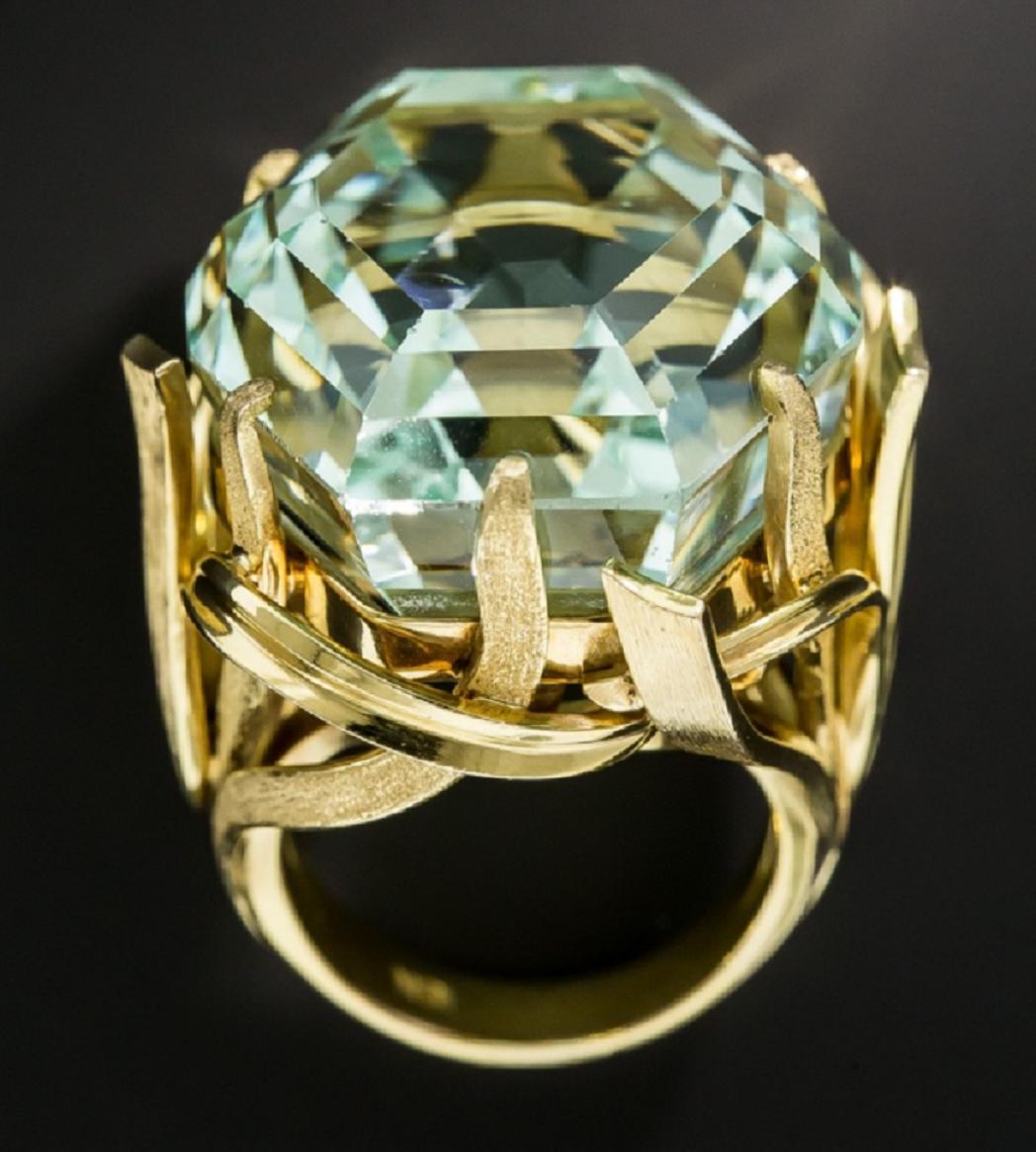 Best massive bling rings 2021 Elegant 70 carat , Enchanting Hexagonal Minty Green Gemstone Enveloped In Flowing Ribbons 18K Yellow Gold Ring