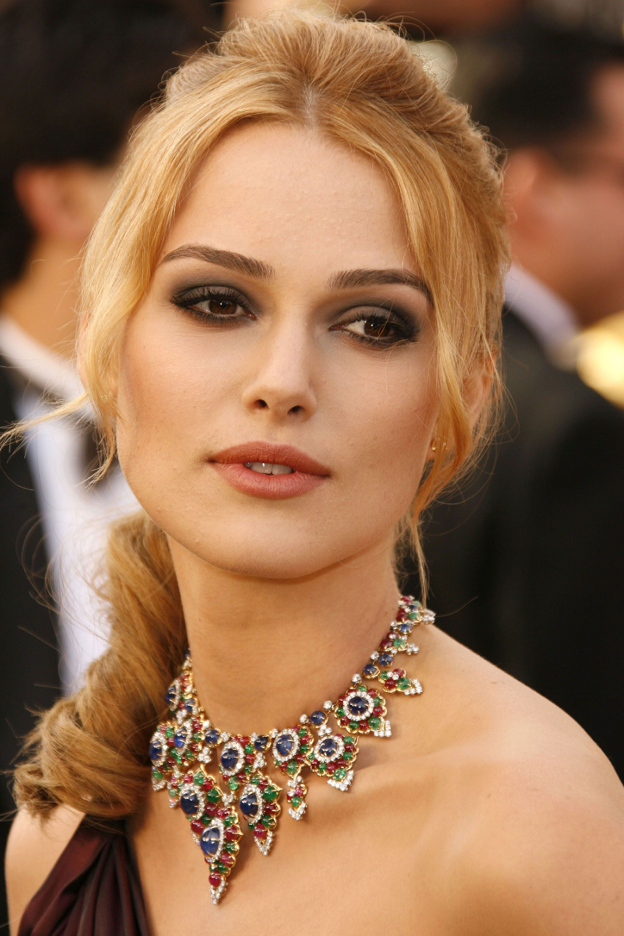 Amazing Hollywood celeb bling Keira Knightley Wearing An Elegant Necklace with Blue Saphire, Emerald and Ruby Stones