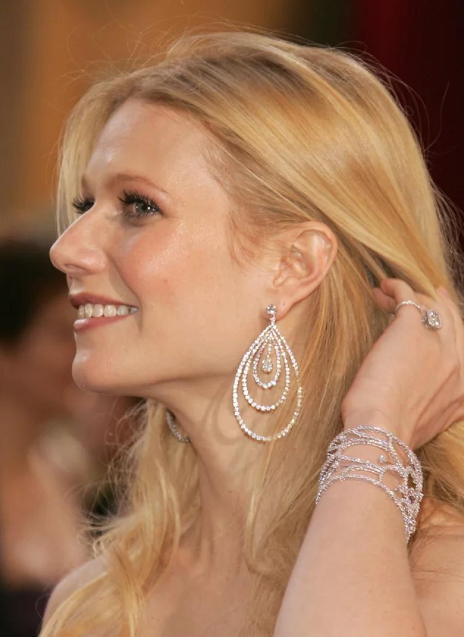 Amazing Hollywood celeb bling Gwyneth Paltrow Wearing Her Diamond Drop Earrings and Matching Diamond Cuff