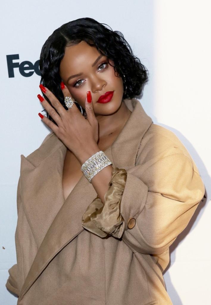 Rihanna Wearing Her Diamond Round Bracelet with Matching Ring